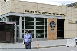 In this 2013 file photo, a Russian policeman stands in front of an entrance of the U.S. Embassy in downtown Moscow.