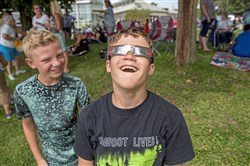 Luke Cline, 13, looks up at the sun in awe with his friend Logan Smetanka, 13, both from Latrobe, during the Solar Eclipse at Saint Vincent College.