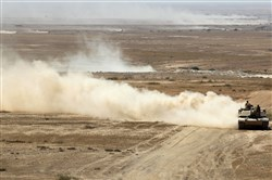 Iraqi forces, backed by Shiite fighters from the Popular Mobilization Forces, advance Monday toward the city of Tal Afar, the main remaining stronghold of the Islamic State group, after the government announced the beginning of an operation to retake it from the extremists.