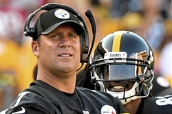 Ben Roethlisberger watches from the sideline against the Falcons on Sunday.