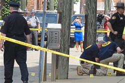 Evidence markers are placed on North Court Street and the sidewalk next to the Jefferson County Courthouse in Steubenville on Monday.