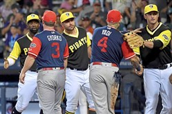 Pirates and Cardinals players shake hands at the end of the MLB Little League Classic at BB&T Ballpark at Historic Bowman Field Sunday in Williamsport, Pa.