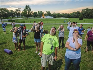Russell Clark, PhD., watches the total eclipse on Monday, August 21, 2017 in Barren Plains, Tenn. Clark was leading a team that is one of 55 in the NASA Eclipse Ballooning Project that are releasing weather balloons along the path of the eclipse. (Andrew Rush/Post-Gazette)