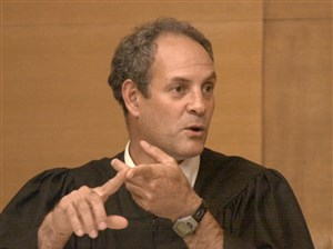 Judge Joseph J. Bruzzese Jr. gives a jury instructions during a trial in 2000.