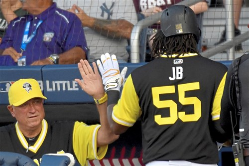 Pirates manager Clint Hurdle congratulates Josh Bell after hitting a two-run home run in the first inning of the MLB Little League Classic at Bowman Field Sunday, August 20, 2017 in Williamsport. (Matt Freed/Post-Gazette)