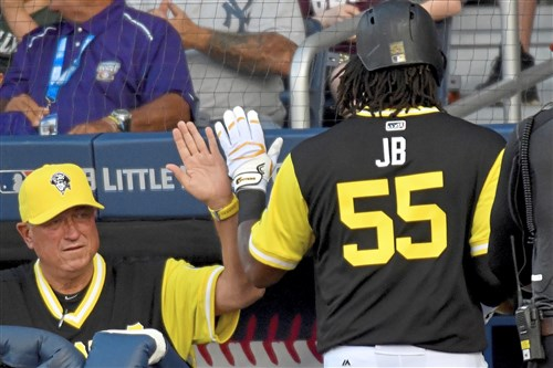 Pirates manager Clint Hurdle congratulates Josh Bell after the first baseman hit a two-run home run in the first inning of the MLB Little League Classic at Bowman Field Sunday in Williamsport.