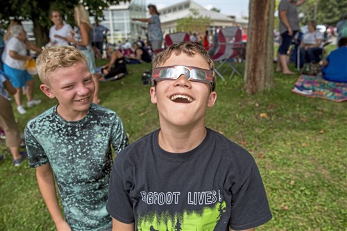 Luke Cline, 13, looks up at the sun in awe with his friend Logan Smetanka, 13, both from Latrobe. during the solar eclipse on Monday at Saint Vincent College.