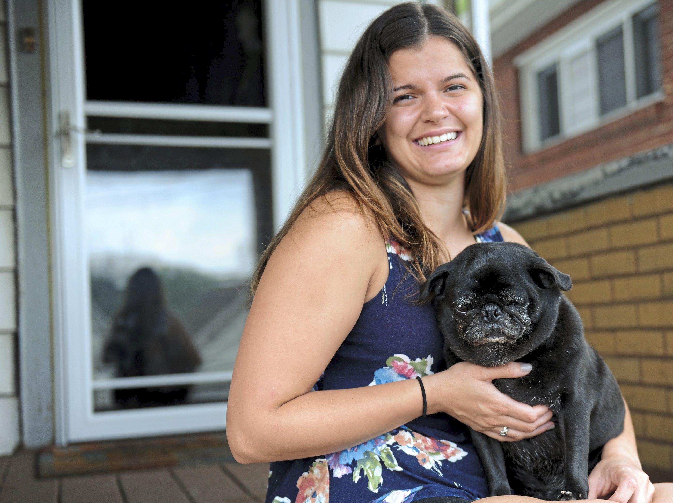 20180810ppSrPetRescue1MAG Stefani Markis sits on her porch in Glassport with Ebony, a 10- to -13-year-old pug she is fostering for Senior Pet and Animal Rescue.