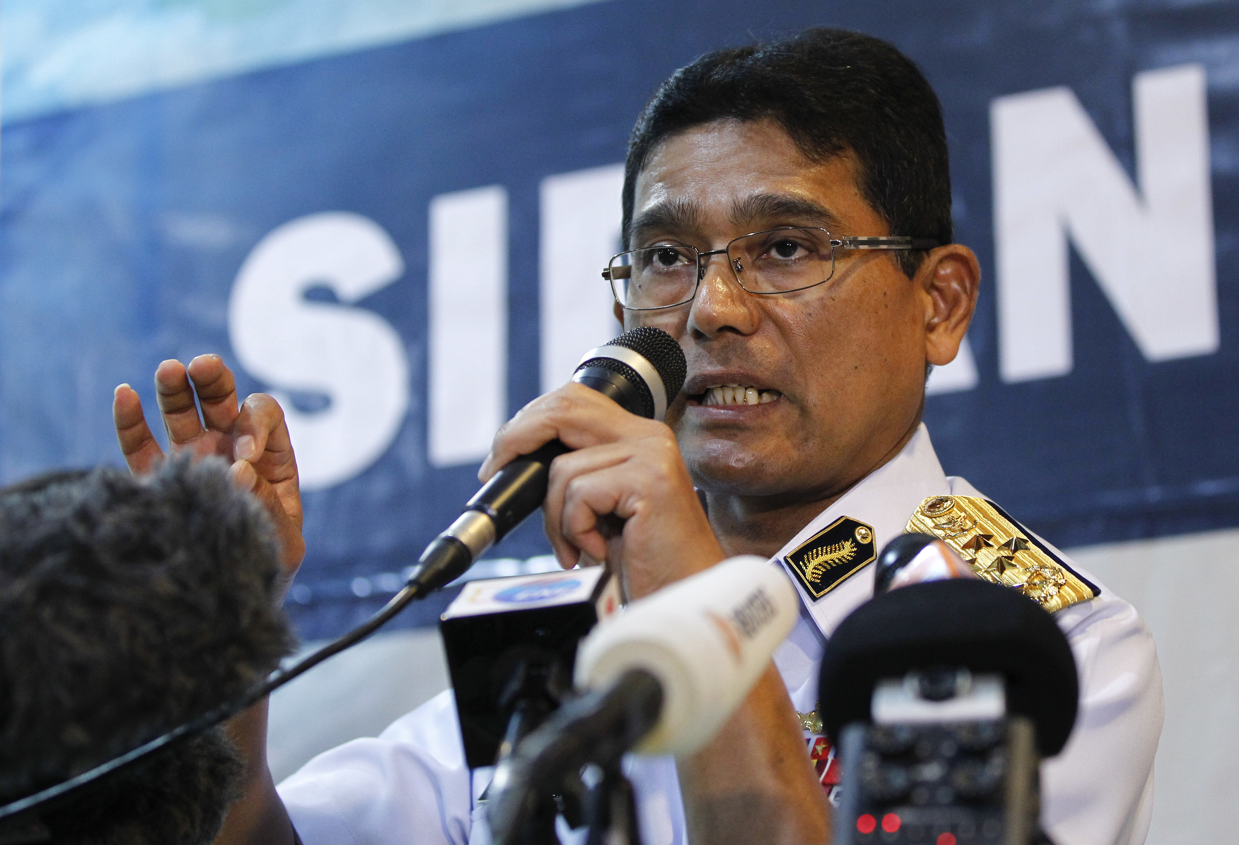 """Malaysia Singapore US Navy Ship Collision-9 Malaysian Maritime Director Indera Abu Bakar speaks during a press conference about a collision of the USS John S. McCain in Putrajaya, Malaysia, Monday, Aug. 21, 2017. The U.S. Navy said the USS John S. McCain arrived at Singapore's naval base with """"significant damage"""" to its hull after a collision early Monday between it and an oil tanker east of Singapore. A number of U.S. sailors are missing after the collision, the second accident involving a ship from the Navy's 7th Fleet in the Pacific in two months. (AP Photo/Daniel Chan)"""