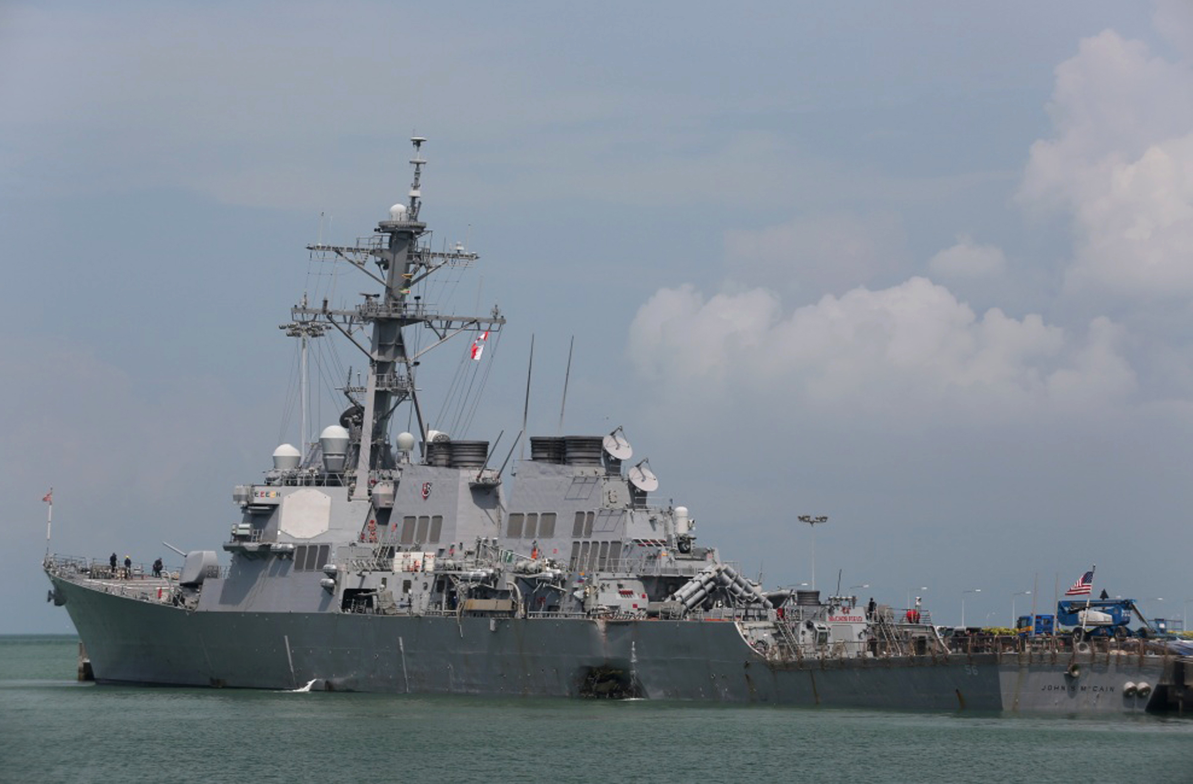 """Singapore US Navy Ship Collision-10 The Guided-missile destroyer USS John S. McCain (DDG 56) is moored pier side at Changi naval base in Singapore following a collision with the merchant vessel Alnic MC Monday, Aug. 21, 2017. The USS John S. McCain was docked at Singapore's naval base with """"significant damage"""" to its hull after an early morning collision with the Alnic MC as vessels from several nations searched Monday for missing U.S. sailors. (Grady T. Fontana/U.S. Navy photo via AP)"""