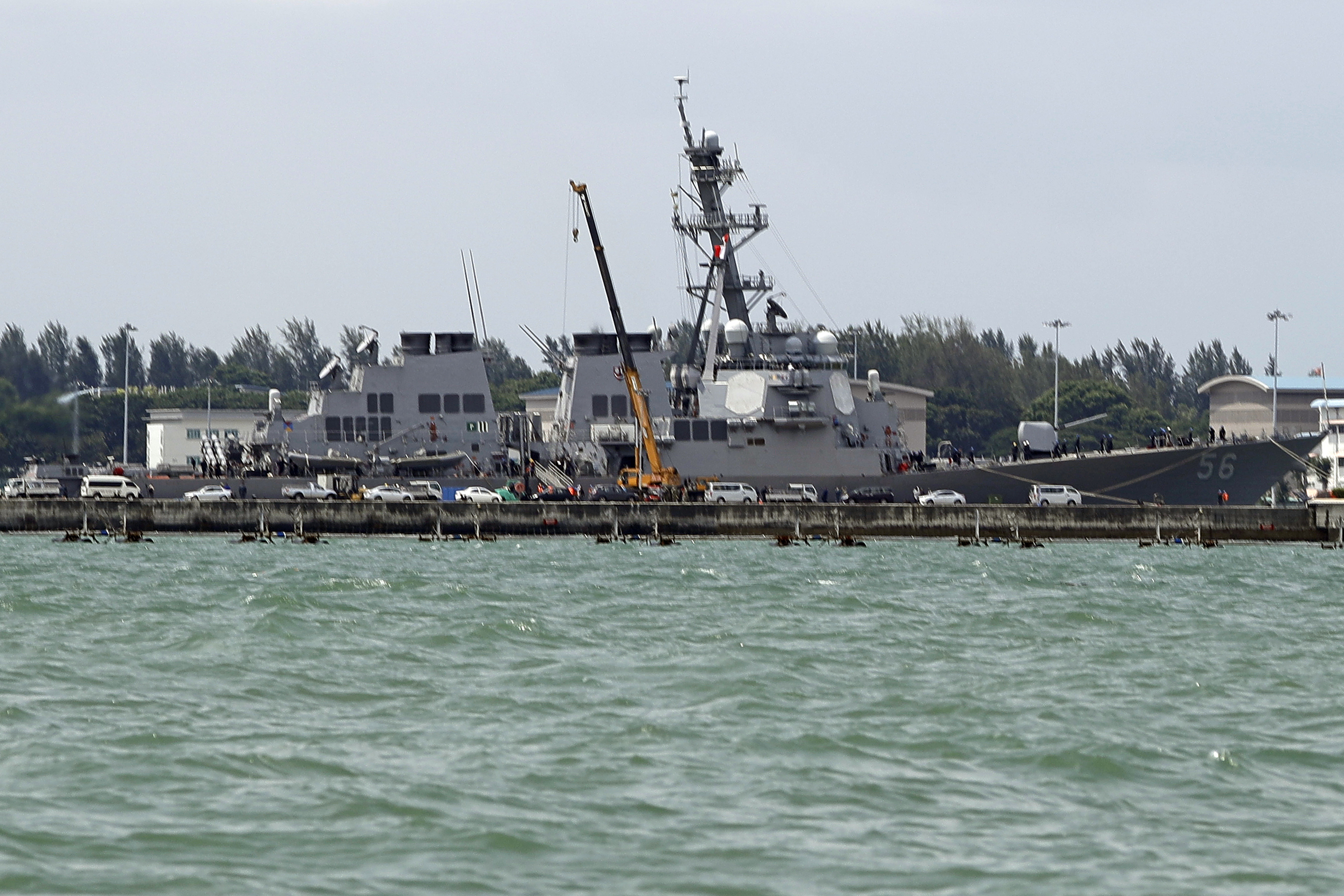 """Singapore US Navy Ship Collision-11 The USS John S. McCain is seen docked at Changi naval base after its accident Monday, Aug. 21, 2017 in Singapore. The USS John S. McCain was docked at Singapore's naval base with """"significant damage"""" to its hull after an early morning collision with the oil tanker Alnic MC as vessels from several nations searched Monday for missing U.S. sailors. (AP Photo/Wong Maye-E)"""