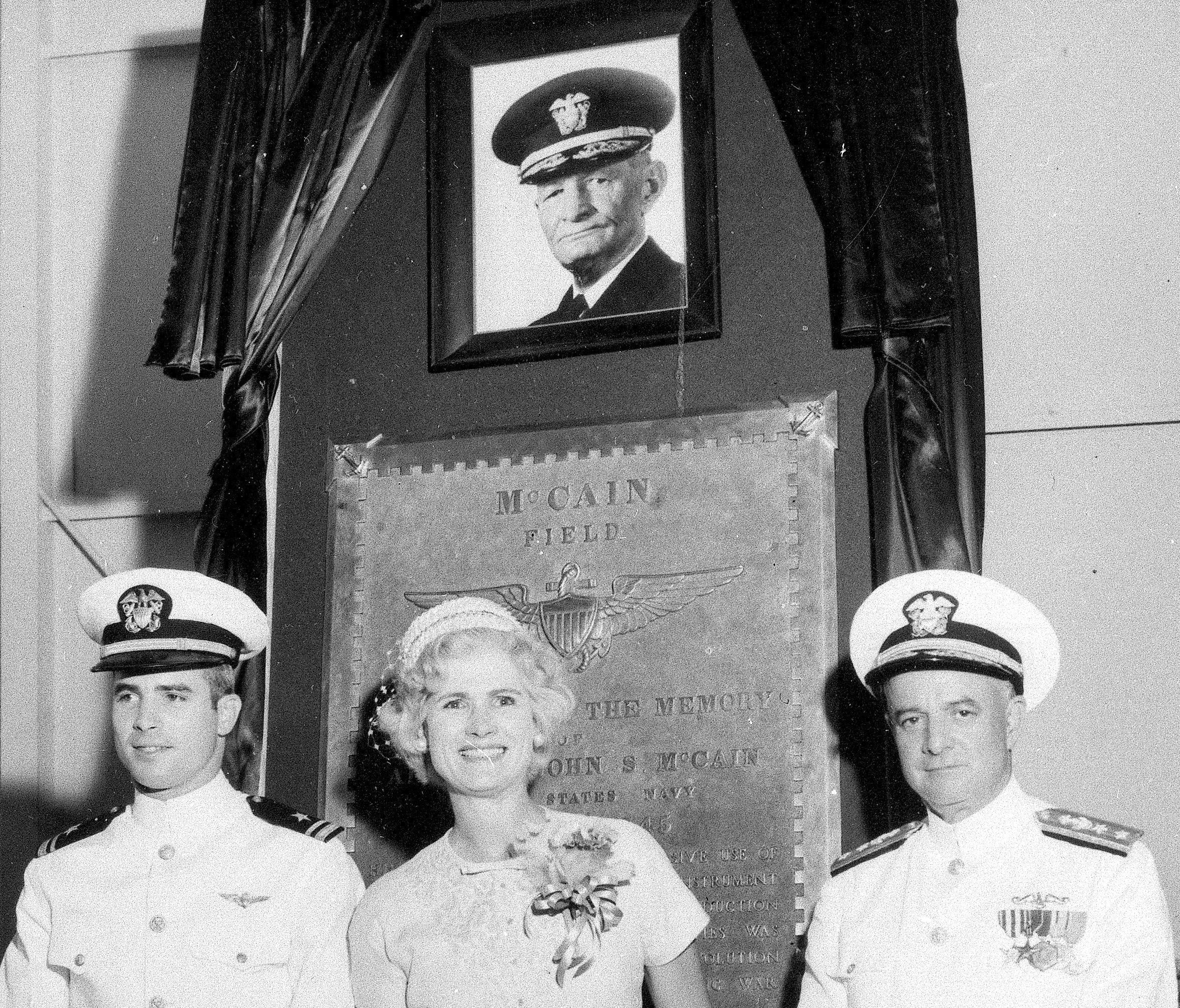 Singapore US Navy Ship Collision-8 FILE - In this July 14, 1961, file photo, then Lt. John S. McCain III, left, and his parents, Rear Adm. John S. McCain Jr. and Roberta Wright McCain take part in the ceremony to commission McCain Field, the U.S. Navy training base in Meridian, Miss., named in honor of Adm. John S. McCain, in photo at top, respectively grandfather and father to the two McCains. Ten U.S. sailors are missing after a collision between the USS John S. McCain and a tanker early Monday, Aug. 21, 2017, east of Singapore, the second accident involving a ship from the Navy's 7th Fleet in the Pacific in two months. The 154-meter (505-foot) McCain is named after U.S. Sen. John McCain's father and grandfather, who were both U.S. admirals. (AP Photo/File)
