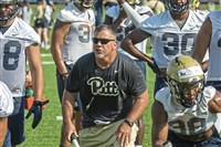 Defensive line coach Charlie Partridge, center, thinks Pitt is well-stocked for the future at his position.