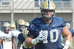 Brian O'Neill, a redshirt junior whom Pitt players and coaches keep pointing to as a team leader, goes through a drill Tuesday morning at practice on the South Side.