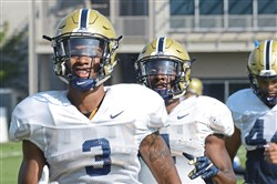 Pitt defensive back Damar Hamlin, left, goes through exercises at practice Tuesday on the South Side.