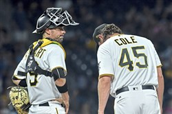 Pirates catcher Chris Stewart stands with right-hander Gerrit Cole as manager Clint Hurdle walks to the mound to remove him from the game after giving up a grand slam to the Dodgers' Curtis Granderson in the seventh inning Monday.