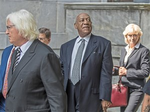 Bill Cosby, center, is surrounded by his new legal team, Tom Mesereau, left, and Kathleen Bliss, right, after leaving the Montgomery Courthouse on Tuesday.