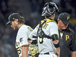 Pirates manager Clint Hurdle takes Gerrit Cole out of the game after he gave up a grand slam to the Dodgers' Curtis Granderson in the seventh inning Monday.