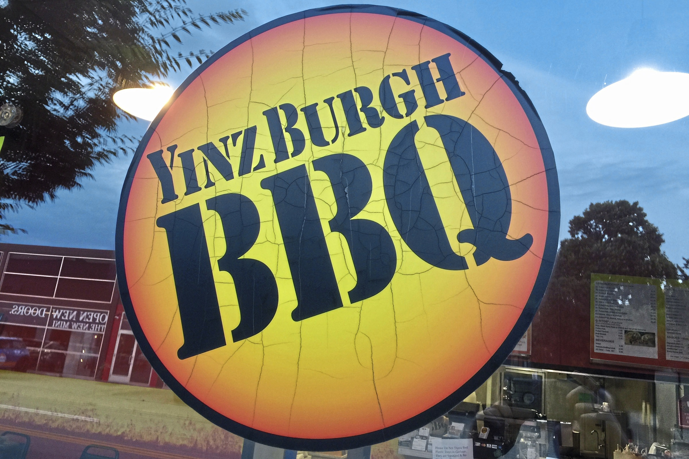 barbeque yinzburgh logo-2 The logo on the window at Yinzburgh BBQ in Oakland