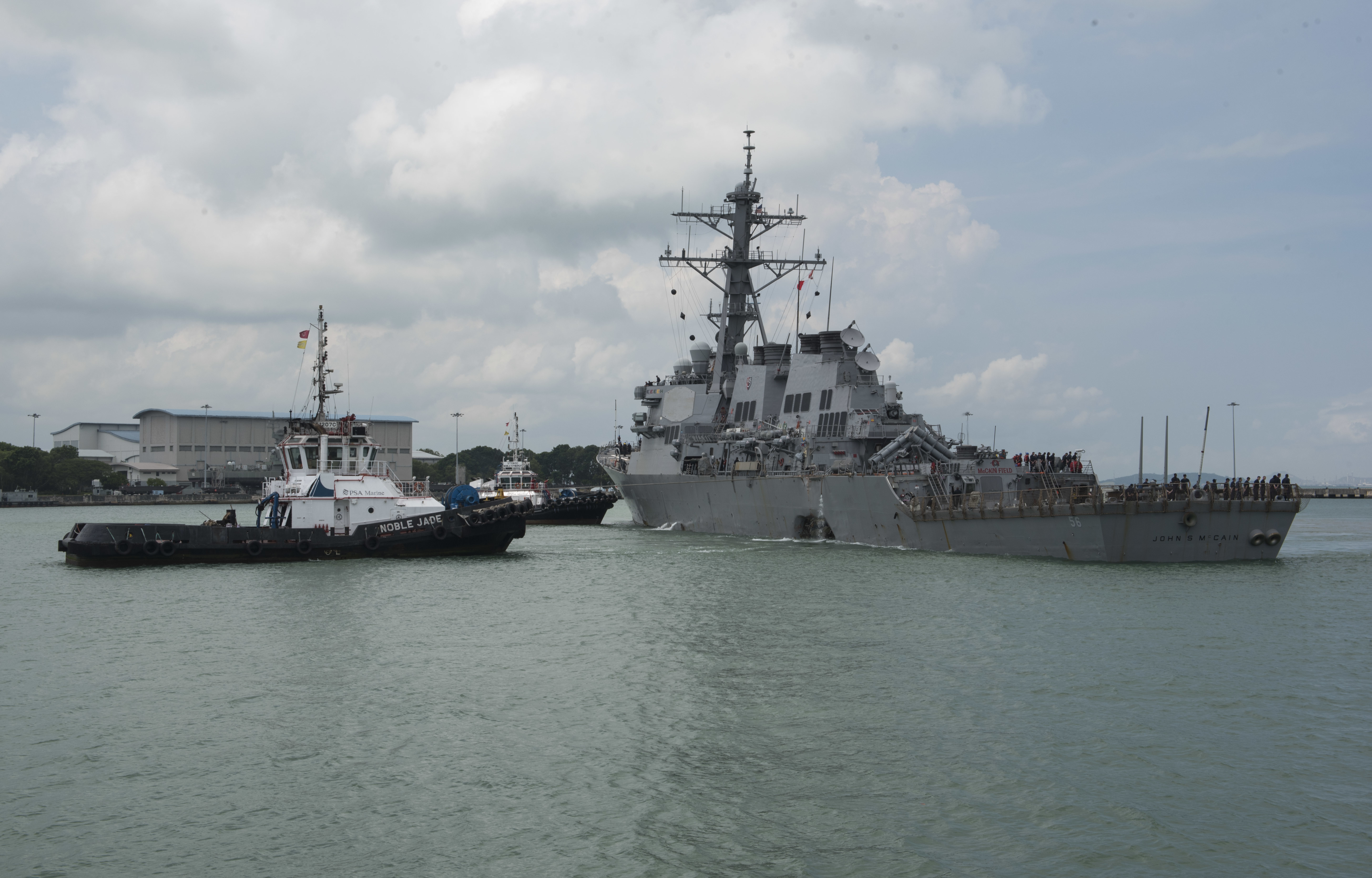 Singapore US Navy Ship Collision-2 In this Aug. 21, 2017, photo provided by U.S. Navy, the guided-missile destroyer USS John S. McCain (DDG 56) steers towards Changi Naval Base, Singapore, following a collision with the merchant vessel Alnic MC while underway east of the Straits of Malacca and Singapore. Navy and Marine Corps divers will enter flooded compartments on the USS John S. McCain to search for 10 sailors missing after the destroyer and an oil tanker collided in Southeast Asian waters, the 7th Fleet said Tuesday, Aug. 22, 2017. (Mass Communication Specialist 2nd Class Joshua Fulton/U.S. Navy via AP)