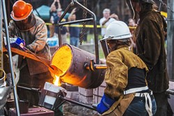 A molten metal pour at a previous Rivers of Steel Festival of Combustion at Carrie Furnaces National Historic Landmark, Rankin. This year's festival will be held Saturday.