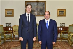 In this photo provided by Egypt's state news agency, MENA, Egypt's President Abdel-Fattah el-Sissi, right, poses for a photo with White House adviser Jared Kushner in Cairo on Wednesday.