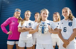 Nationally-ranked Norwin girls soccer members and Division-I recruits Sam Wexell (Ohio), Alyssa Victor (Duquesne), Eva Frankovic (Kent State), Madison Genicola (Duquesne), Emily Harrigan (Rutgers) and Alexis Kendro (Duquesne) pose for a portrait on Wednesday, Aug. 23, 2017 at Norwin High School in North Huntingdon. (Steph Chambers/Post-Gazette)