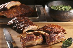 A Spanish-inspired marinade of paprika, pounded garlic and olive oil lends an earthy depth to ribs made in the oven.