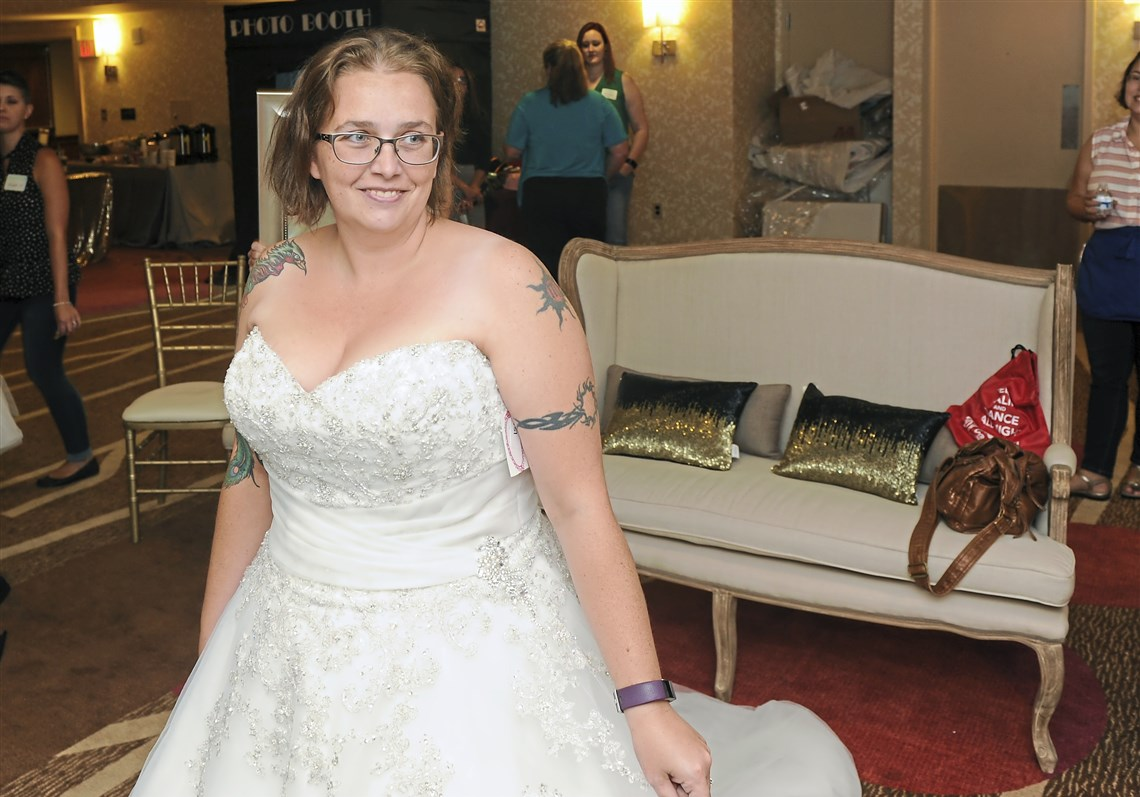 Dress rescue aims to help brides hurt by alfred angelo closure melissa francis of proctor wv tries on a wedding dress during the ombrellifo Image collections