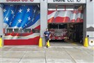 A lone New York firefighter stands outside Ladder Co. 10 in lower Manhattan on Aug. 7, 2017.