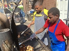 Drew Allen, left, and Ismael Jones tend to chicken on one of the smokers at Showcase BBQ in Homewood.