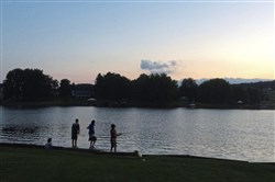 Children fish on Somerset County's Lake Stonycreek on a perfect Saturday night this summer.