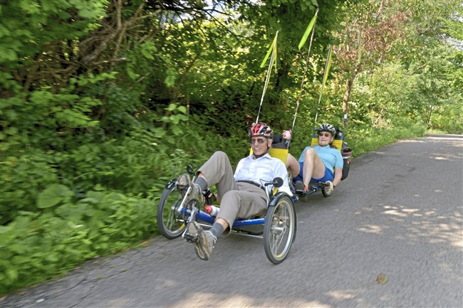Roy Weil and Mary Shaw cruise along on their tandem recumbent cycle along the Three Rivers Heritage Trail.