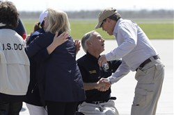 Texas Gov. Greg Abbott, center, greets Energy Secretary Rick Perry, right, as they prepare to visit areas affected by Hurricane Harvey on Thursday in Corpus Christi, Texas.