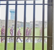 Inmates walk outside at SCI-Somerset prison in August.