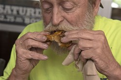 Tom Horstman, from Mount Washington, dines on wings at Bigham Tavern earlier this year.