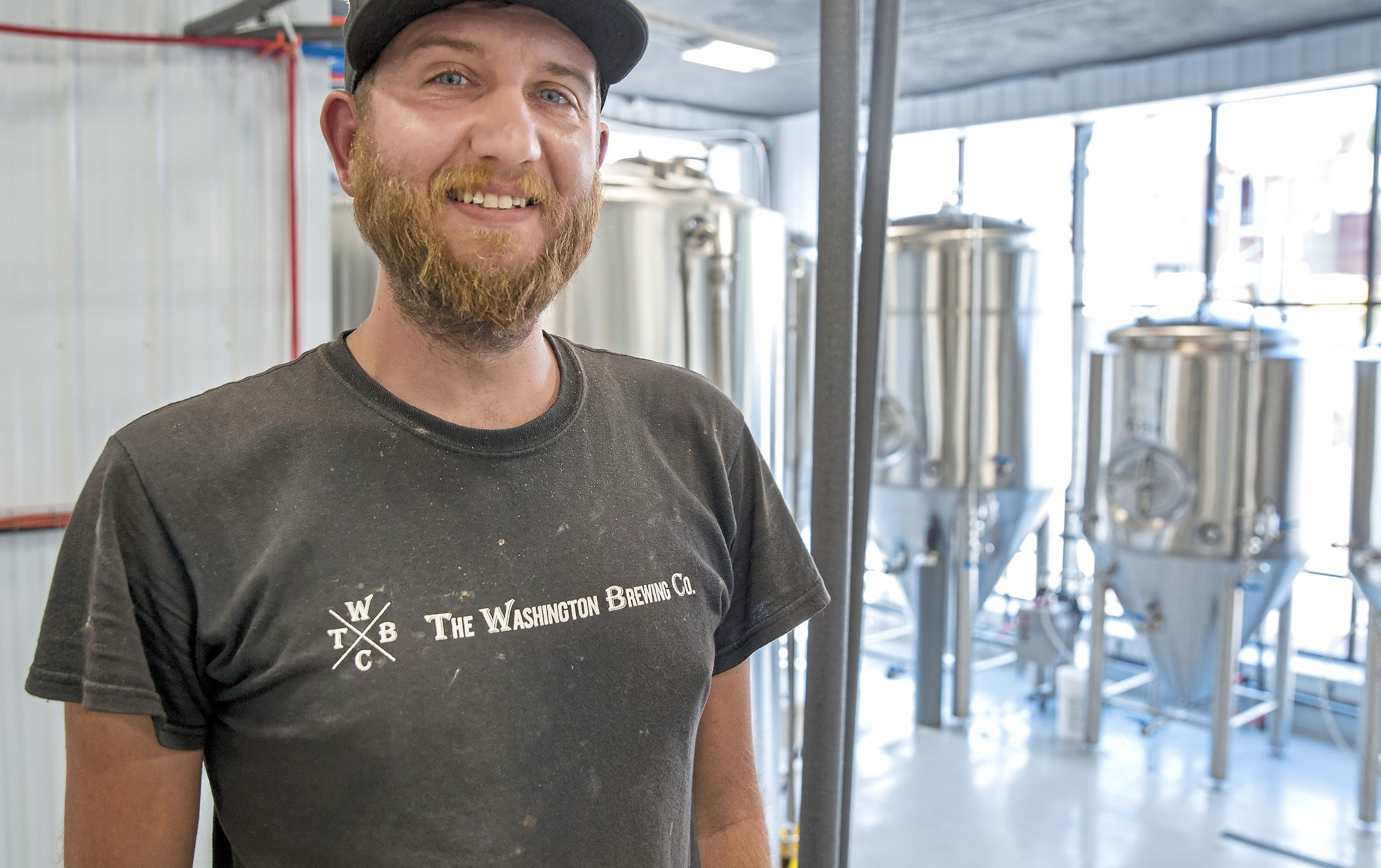 20170830acWashingtonBrewCo-02-1 Brandon Kolljeski, of Cecil, is one of the main brewers at the new Washington Brewing Co. set to open on Sept. 8 in Washington, Pa.