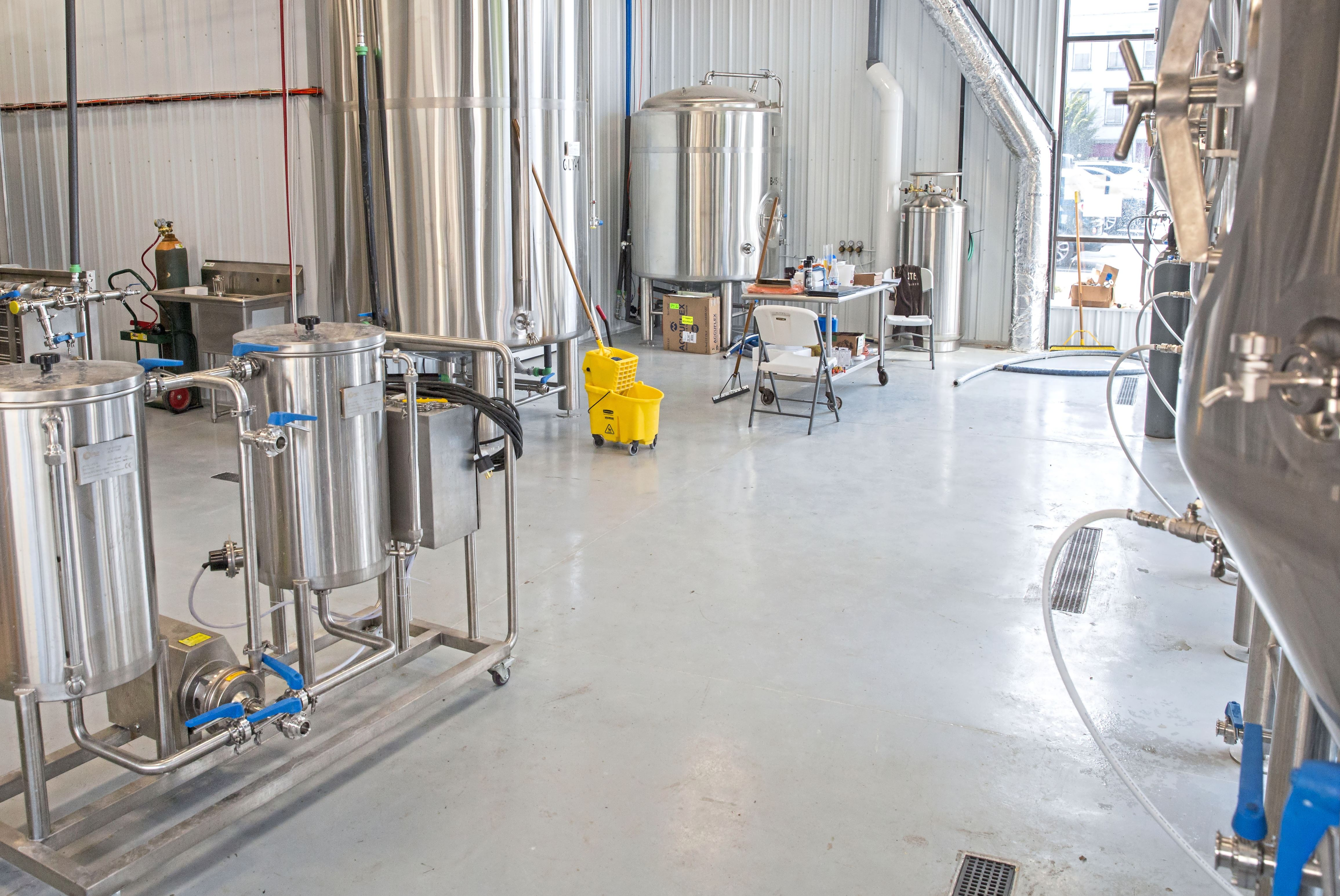 20170830acWashingtonBrewCo-05-1 One of the main rooms that has four 15 barrels of fermenters and two 30 barrel fermenters that are described as huge kegs at the Washington Brewing Co. The Washington Brewing Co. is set to open on Sept. 8 in Washington.