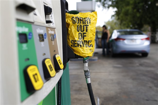 """A """"Sorry out of Service"""" sign is placed on one of the gas pumps at a gas station in Athens, Ga., on Friday. Gasoline prices in the U.S. have risen to new high amid continuing fears of shortages in Texas and other states after Hurricane Harvey's strike."""