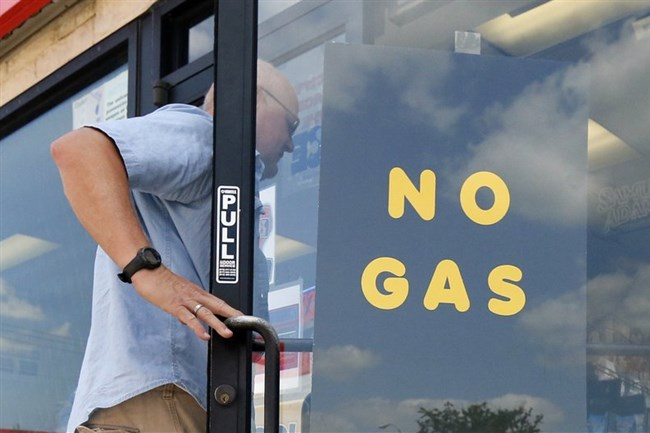 """A customer walks into an Exxon filling station and convenience store location where a sign on the door reads, """"No Gas,"""" Thursday, Aug. 31, 2017, in Bedford, Texas. It's getting harder to fill gas tanks in parts of Texas where some stations are out of fuel and pump costs are spiking. A major gasoline pipeline shuttered due to Harvey may be able to resume shipping fuel from the Houston area by Sunday, which could ease gasoline shortages across the southern U.S."""