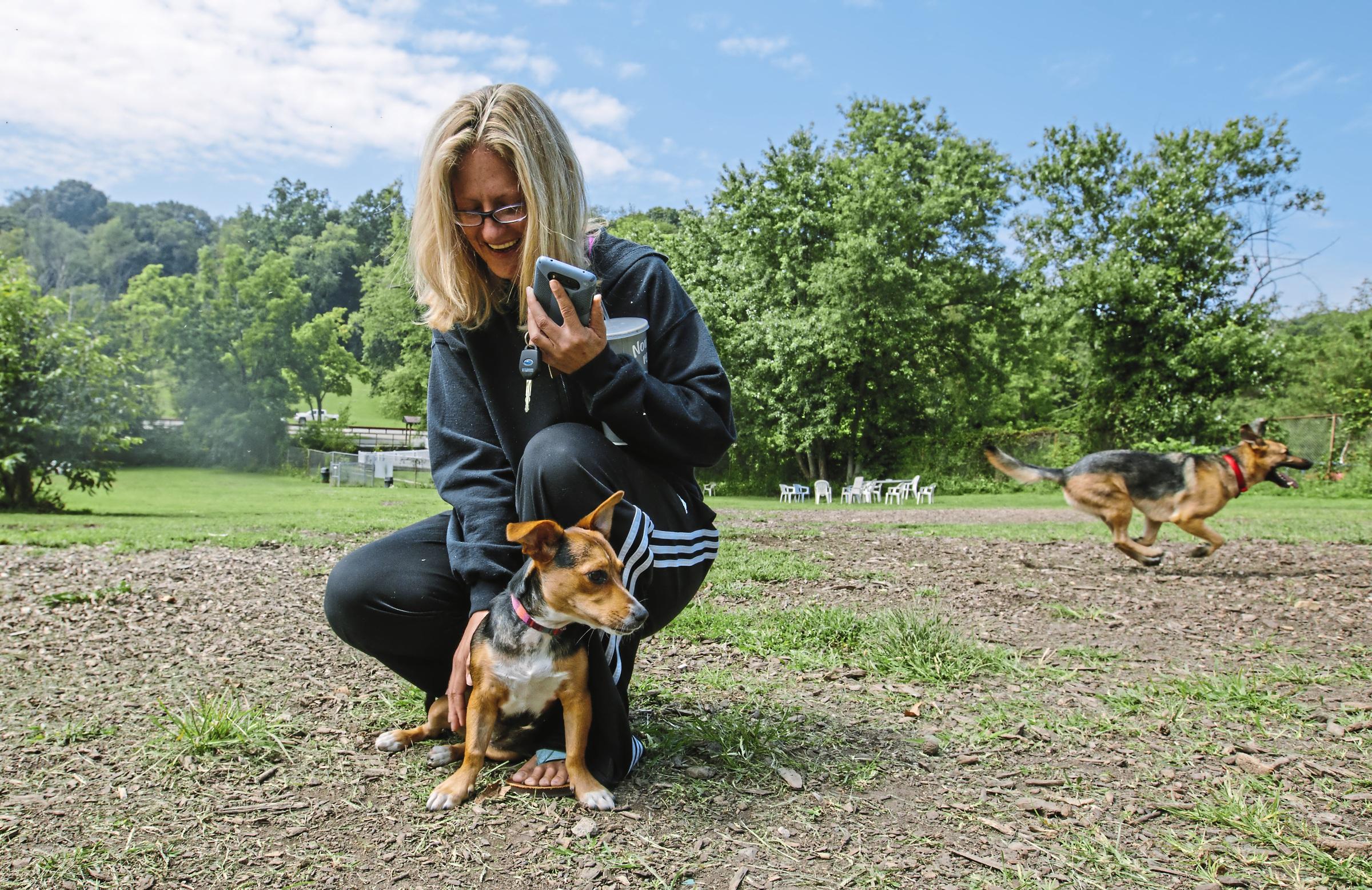 20170829arDogParks03-2 Emily Kiener of Bethel Park with her dog, Madison, at the South Park Dog Park.