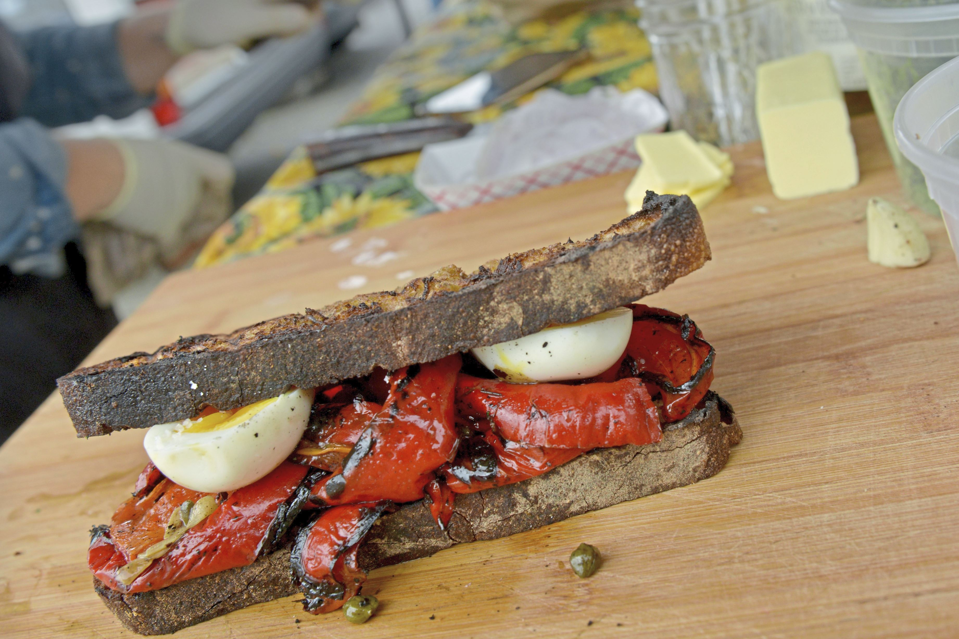 20170902ppFarmersMkt7FOOD-3 A roasted pepper and egg sandwich on toast prepared by Becca Hegarty, with Bitter Ends Garden & Luncheonette in Verona.