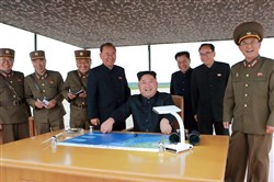 Not all fun and games: An official photo from North Korea said to show leader Kim Jong Un watching a ballistic rocket launch last month.