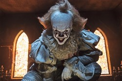 "Despite the smile, Pennywise the Dancing Clown (Bill Skarsgard) is not a fun guy in Warner Bros. Picturers' ""It."""