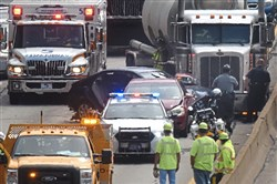 A car was pinned beneath a tanker truck in the westbound lanes of Parkway East on Wednesday.