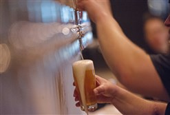 A server pours a draft beer at Hitchhiker Brewing Co. in Sharpsburg.