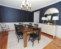 Christine McCall's dining room features navy blue grasscloth wallpaper and a table made by Penn Rustics of Penn Township.