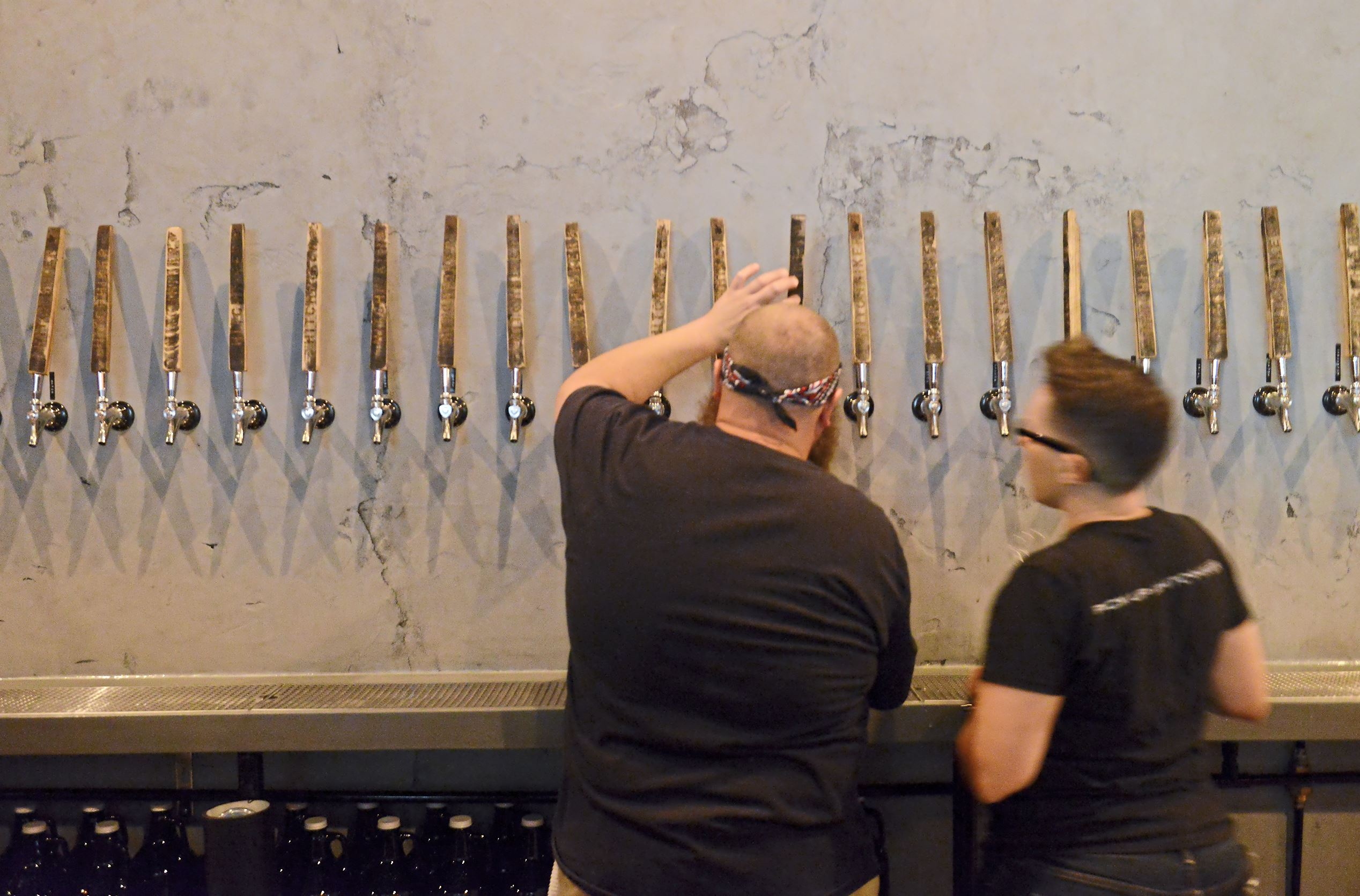 20170906rldHitchhiker03-1 Bartenders pour beer during Hitchhiker Brewing Co.'s launch party celebrating the opening of its second location Wednesday in Sharpsburg.
