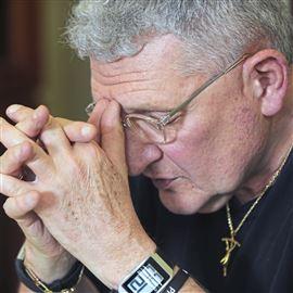 Bishop David Zubik, pray before having lunch with priests July 28, 2017, at