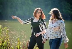 Kathryn Hyslop walks South Fayette High School senior Emily Simms through her photo shoot at North Park.